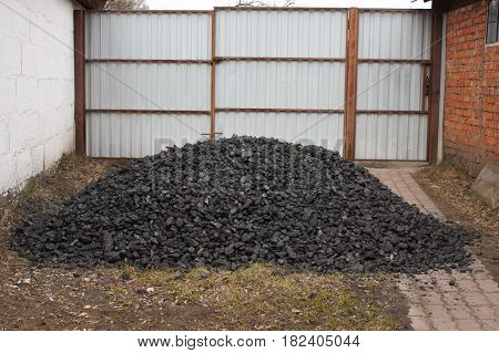 A bunch of anthracite for heating a rural house in the yard