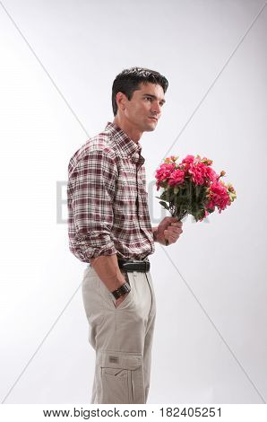 The handsome boyfriend is holding some flowers.