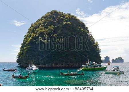 Tropical islands and longtail boats. Cristal clear water.