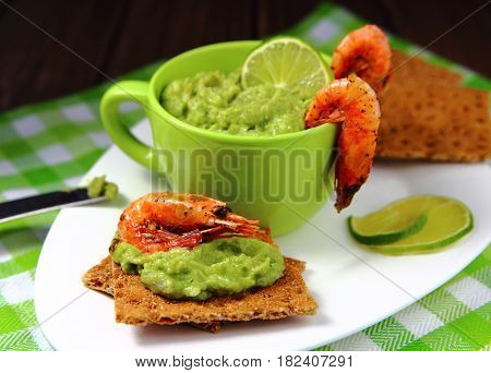 appetizer of  avocado in a Cup with shrimp grilled