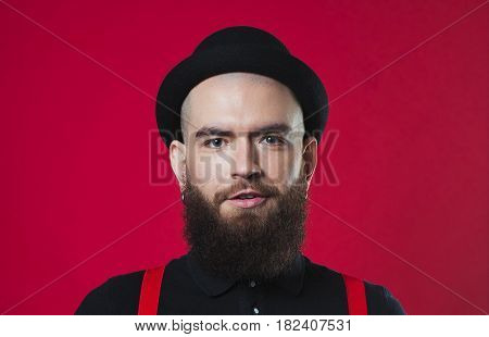 Bearded Guy On A Red Background
