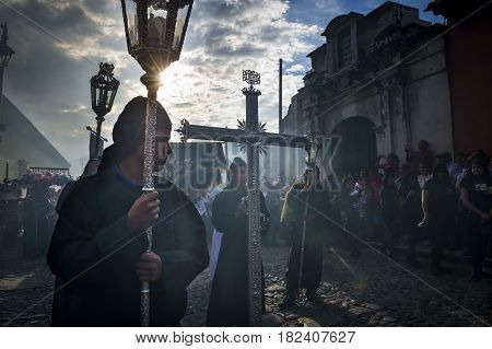 Antigua Guatemala - April 19 2014: Penitents in an Easter procession during the Holy Week in Antigua Guatemala