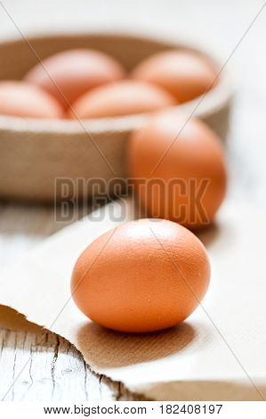various chicken eggs on the inside of pot in the first focal plane