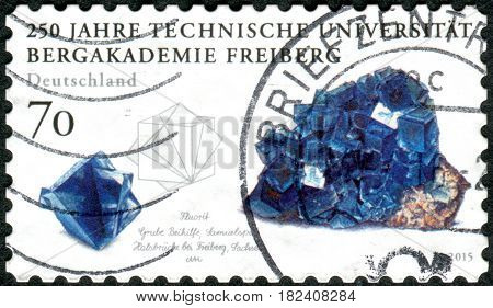 GERMANY - CIRCA 2015: A stamp printed in Germany dedicated to the Mining Academy in Freiberg shows a Fluorite circa 2015
