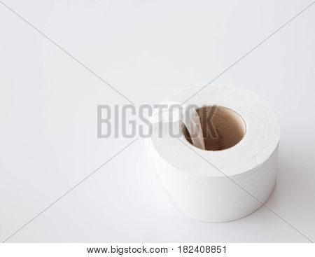 Large paper roll on the white table for used in the public toilet