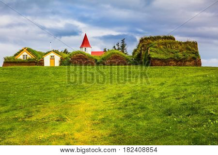 Farm Museum in Glaumbaer. The picturesque village of old houses covered with turf and grass. The concept of the ethnographic and cultural tourism
