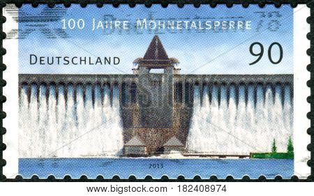 GERMANY - CIRCA 2013: A stamp printed in Germany dedicated to the 100 years Moehne Reservoir shows a dam circa 2013