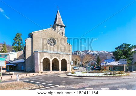 Medieval church on the central square of megeve French Alps