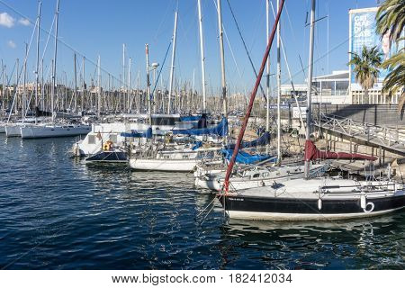 BARCELONA SPAIN - February 9, 2017: street view of Barcelona harbor with boats, is the capital city of the autonomous community of Catalonia in the Kingdom of Spain,February 9, 2017 in Barcelona Spain
