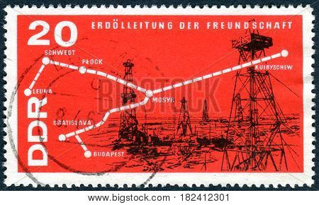 GERMANY - CIRCA 1966: A stamp printed in Germany (GDR) shows Map of Oil Pipeline and Oil Field circa 1966