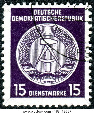 GERMANY - CIRCA 1954: A stamp printed in Germany (GDR) shows a state emblem circa 1954