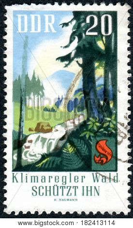 GERMANY - CIRCA 1969: A stamp printed in Germany (GDR) shows the forests as regulators of climate circa 1969