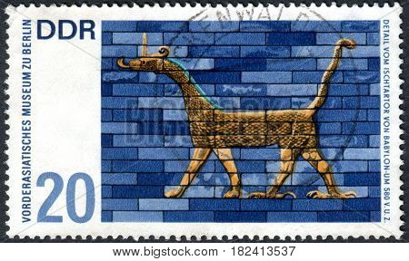 GERMANY - CIRCA 1966: A stamp printed in Germany (GDR) shows the detail from Ishtar Gate Babylon. Artwork from Near Eastern Museum Berlin circa 1966