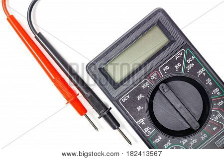 Fragment of digital multimeter with probes closeup on a white background