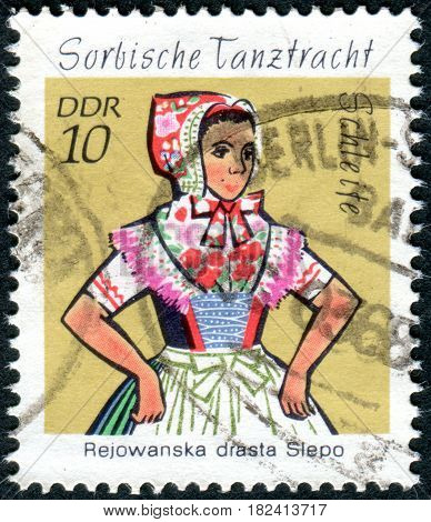 GERMANY - CIRCA 1971: A stamp printed in Germany (GDR) shows the Sorbian Dance Costumes from Schleife circa 1971