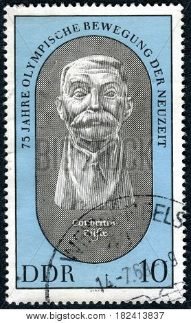 GERMANY - CIRCA 1969: A stamp printed in Germany (GDR) dedicated to the revival of the Olympic Games shows the bust of Pierre de Coubertin by Wieland Forster circa 1969
