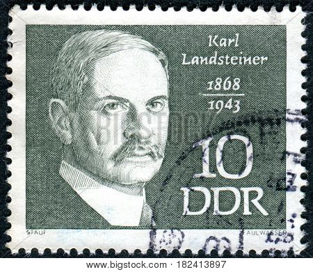 GERMANY - CIRCA 1968: A stamp printed in Germany (GDR) shows an Austrian biologist and physician Karl Landsteiner circa 1968