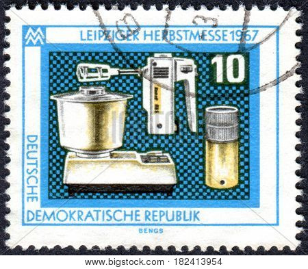 GERMANY - CIRCA 1967: A stamp printed in Germany (GDR) dedicated to Leipzig autumn fair shows a Electric kitchen appliances circa 1967