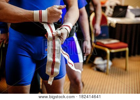 hands athlete powerlifter in wristbands competition powerlifting