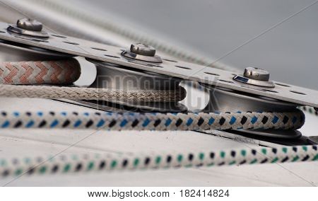 Details of yacht rigging with ship ropes. Close-up.