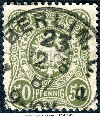 GERMANY - CIRCA 1880: A stamp printed in Germany (Deutsches Reich) shows a Imperial eagle and crown in oval circa 1880