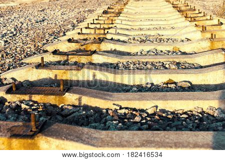 Old, Dirty And Rusty Used Concrete Railway Ties Stored After Big Reconstruction Of Old Railway Stati