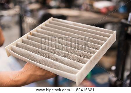 Close up used air filter of car.