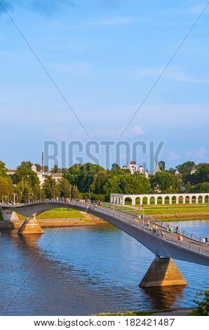 Birds eye view of Yaroslav Courtyard and footbridge across the Volkhov river in summer sunny evening in Veliky Novgorod Russia. Architecture landscape of Veliky Novgorod Russia
