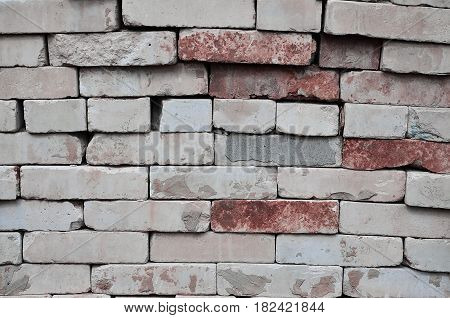 A Photo Of A Set Of Old Bricks That Are Stacked In A Multilayered Pile Of Neat Rows