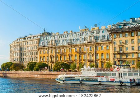 ST PETERSBURG RUSSIA-OCTOBER 3 2016. St Petersburg city view - Mytninskaya embankment and city buildings near the Neva river. In the center - historic apartment house of P.S. Obolensky.Architecture landscape of St Petersburg, Russia