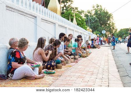 Luang Prabang, Laos - Jun 13 2015: Buddhist Alms Giving Ceremony In The Morning. The Tradition Of Gi