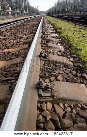 railroad tracks receding to the horizon line