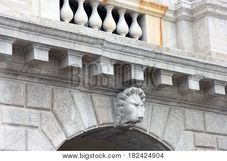 medieval roman marble wicked lion head in italian arch Venice Italy