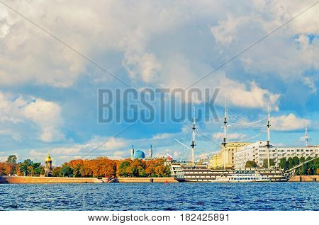 ST PETERSBURG RUSSIA- OCTOBER 3 2016. Petrovsky embankment Neva river and frigate Grace in St Petersburg Russia.Frigate is a historical reconstruction of the three-Decker ships of the XVIII century. St Petersburg, Russia landscape