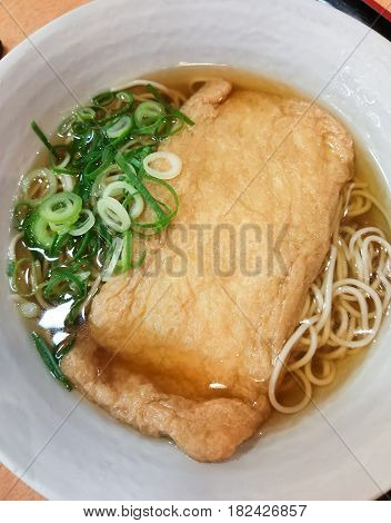 Japanese Soba noodle ramen with fried tofu in ceramic bowl, Japanese food