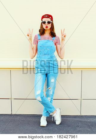 Fashion Pretty Young Woman Wearing A Denim Jumpsuit Over White Background