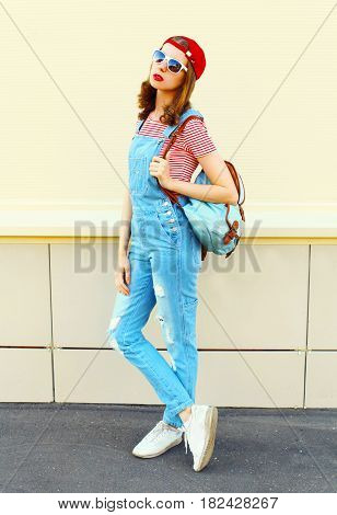 Fashion Young Pretty Woman Wearing A Denim Jumpsuit Over White Background