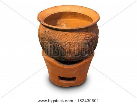 Clay pot on clay stove isolated on white background