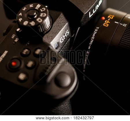 PARIS FRANCE - APR 9 2017: Close-up detail of buttons Panasonic Lumix DMC-GH5 - and Leica Vario-Elmarit 12-60 Micro Four Thirds System digital still and video camera with 4K 10 bit Video recording internal capability.