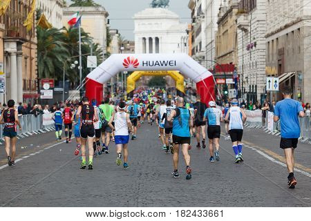 Rome Italy - April 2nd 2017: Athletes of the 23th Rome Marathon to step in Via Nazionale a few kilometers from the finish.