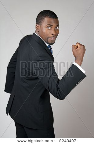 Business Man Showing His Strength