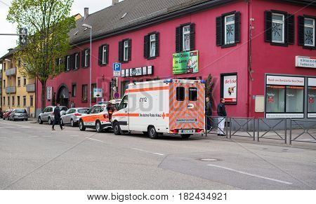 KEHL GERMANY - CIRCA 2017: Ambulance doctor arriving fast in BMW SUV and Mercedes-Benz Ambulance Van at the place of the accident at the Hauptstrase in German city of Kehl - Deutsches Rotes Kreuz