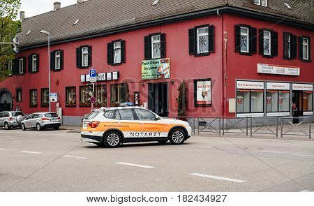 KEHL GERMANY - CIRCA 2017: Fast Ambulance doctor arriving fast in BMW SUV at the place of the accident at the Hauptstrase in German city of Kehl - Deutsches Rotes Kreuz