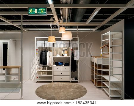 PARIS FRANCE - APR 10 2017: Modern wardrobe cabinet clothes choosing furniture in IKEA Shopping furniture store in Paris France. Being founded in Sweden in 1943 IKEA is the world's largest furniture retailer.