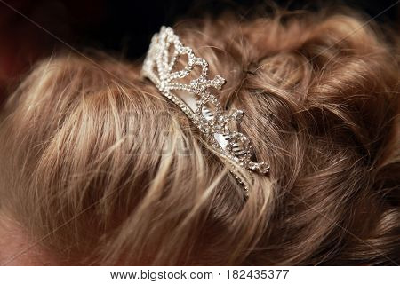 Wedding tiara in bride hair close-up .