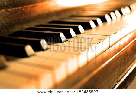 Old vintage piano with ebony and ivory keys black and white