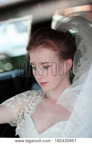 Portrait of a beautiful bride in the car.