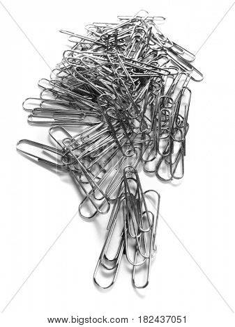 Pile of Silver metal paperclips office supplies closeup