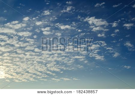 Sky background. Dramatic sunset cloudy sky with clouds lit by sunlight - natural sky background with colorful sky and clouds. Natural sky landscape