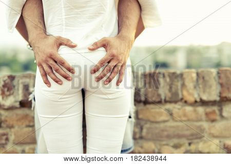 Sexual desire displayed by hands placed on butts